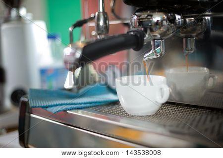 Coffee machine making espresso in a cafe shop