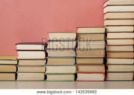Stack of colorful books. Education background. Back to school. Copy space for text
