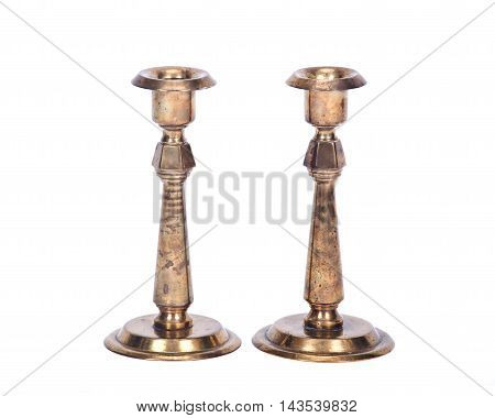 Vintage brass candle holder separated on white background