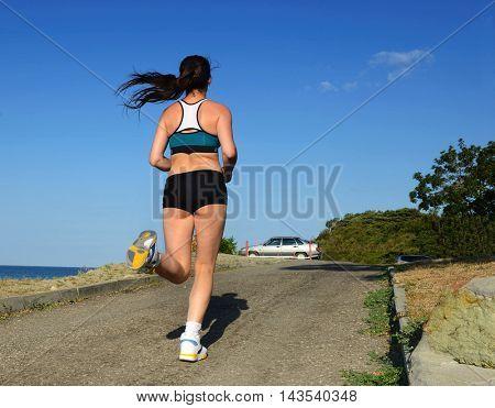 girl on morning jog in nature.