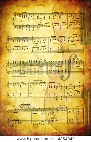 Grunge background with sheet music and a cello.  Great textures of paper and stone.