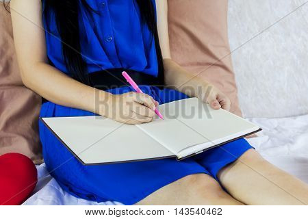 Women Hand Writing Down On Blank Workbook Or Booklet