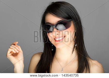 Smiling woman portrait wearing sunglasses