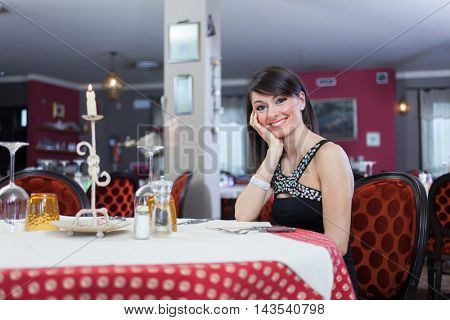 Woman waiting in a restaurant