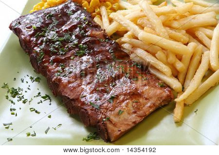 BBQ marinated spareribs and fries, with sweet corn.