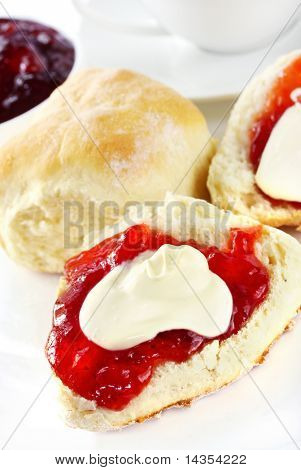 Fresh scones with strawberry jam and fresh cream, served with a cup of tea.  Known as a Devonshire tea or cream tea.