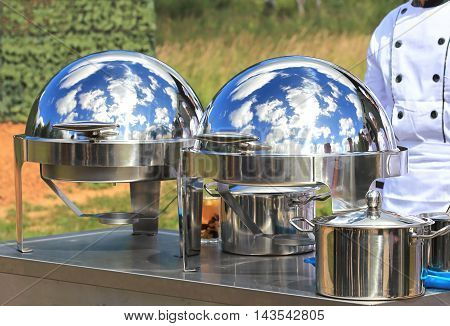 Kitchenware containers with ready meals in army field kitchen