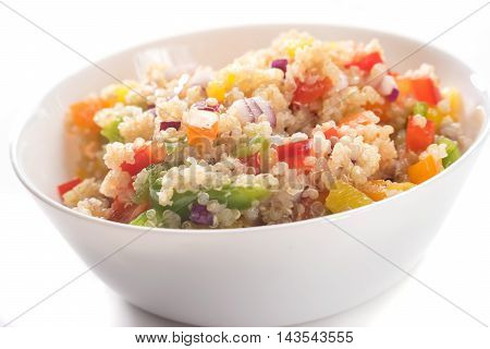 Colorful quinoa salad with vegetables isolated on white