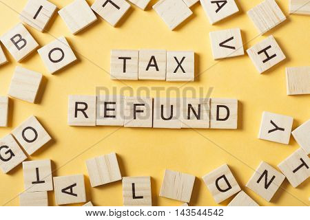 tax refund text on wooden cubes. wood abc at table