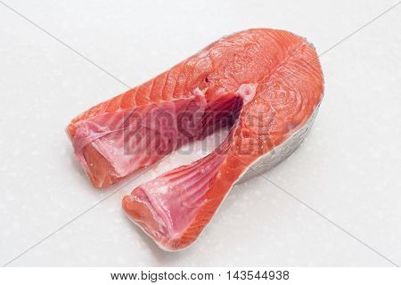 raw salmon fillet isolated on white background for cooking