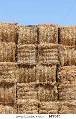 Hay Bales Wall Against Blue Sky