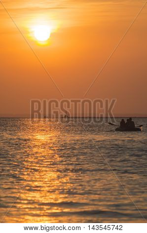 sunset over the quiet sea in the summer
