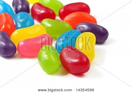 A pile of jellybeans, on a white surface.