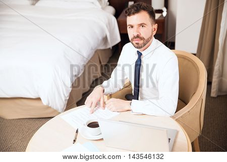 Young Businessman Working In A Hotel Room