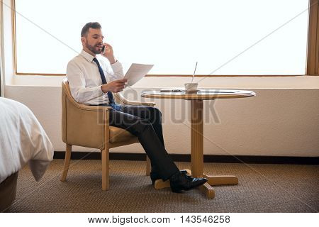Business Manager Working In A Hotel Room
