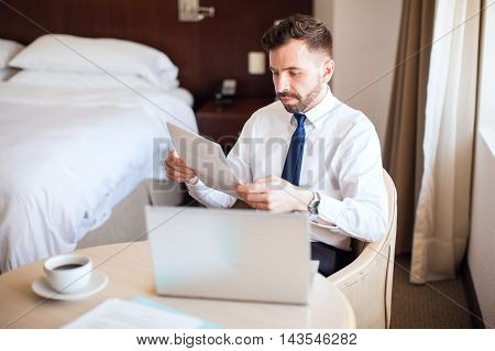 Businessman Doing Some Work At A Hotel