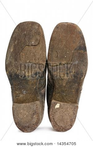 Worn soles of old workboots, isolated on white.  These boots have been worn since the 1940's.