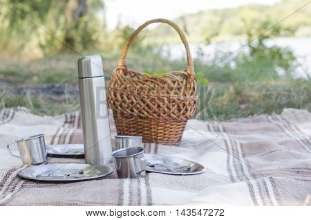 ware on a plaid for picnic outdoors