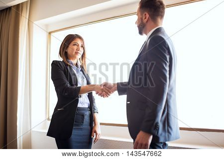 Businesswoman Giving Handshake To A Client