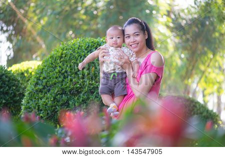 mother and son in the park of Thailand