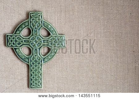 christian green cross on burlap for st patricks day and easter
