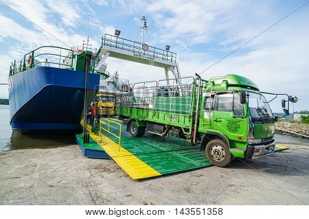 Menumbok,Sabah-Aug 19,2016:PutraJaya ferry vehicle unloading at harbour on 19th Aug 2016 at Menumbok,Sabah.This is the economical transportation to the Labuan island Pearl of Borneo from Sabah Borneo.