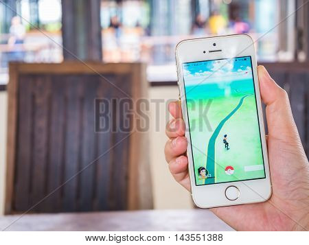 CHIANGRAI THAILAND - August 17 2016: Person holding mobile phone and showing Pokemon Go game application. Pokemon Go is a location-based augmented reality mobile game.