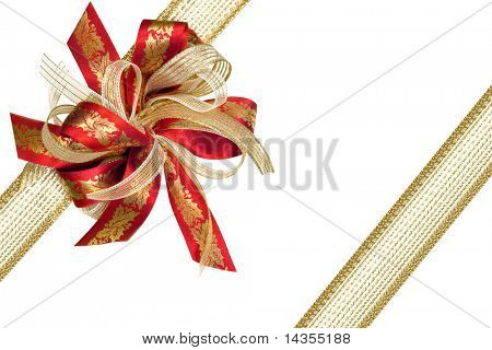 Red and gold Christmas ribbon bow and brocade ribbon, with holly.  Isolated on white.