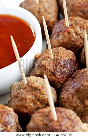 A platter of tasty meatballs, with a savory dipping sauce.  Perfect party food or appetiser.  Selective focus.