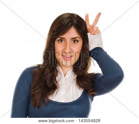An attractive young woman showing sign of victory on white background
