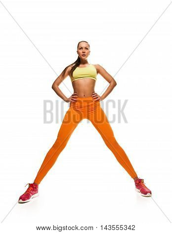fitness woman. Young sporty Caucasian female model isolated on white background in full body. stretching legs