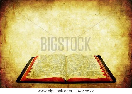 Open Bible over grunge sandstone background.