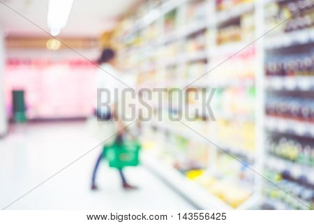 Blur Background Of Woman Customer Select Product On Shelf In Supermarket