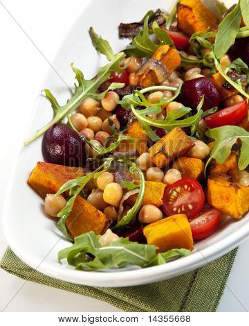 Salad with chickpeas, roasted vegetables, baby beets, cherry tomatoes, and arugula.  Delicious vegetarian eating.