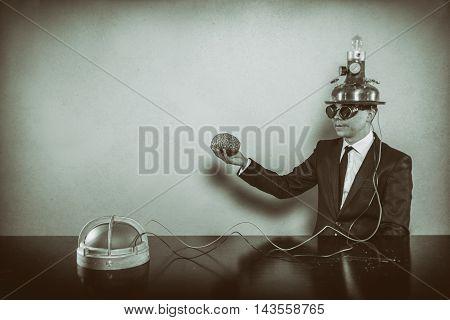 Vintage businessman sitting at office desk with alert light