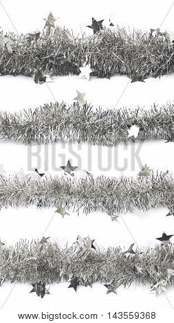 Line of a silver tinsel decorational Christmas garland isolated over the white background, set of four different foreshortenings