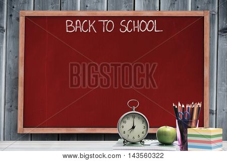 Thank you message against blackboard with copy space on wooden board