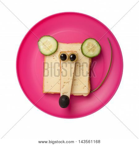 Funny mouse made of bread and cheese on red plate