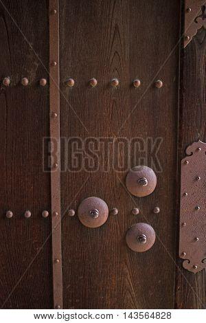 Old wood background texture. Vintage warehouse door and metal element.