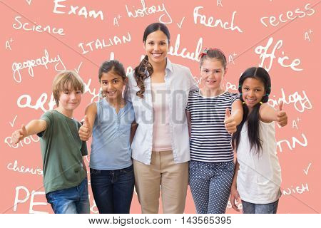 Cute pupils and teacher smiling at camera in computer class against salmon background