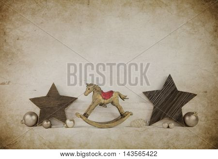 Handmade wooden christmas decoration in old style with stars and a horse.