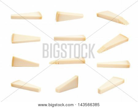Piece of a parmesan cheese isolated over the white background, set of multiple different foreshortenings