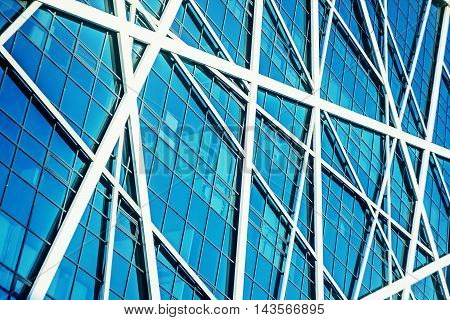 Exterior of Glass Business Building on a Clear Sky Background