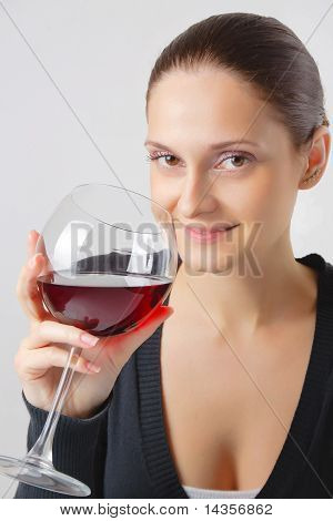 Beautiful Young Lady With A Glass Of Wine