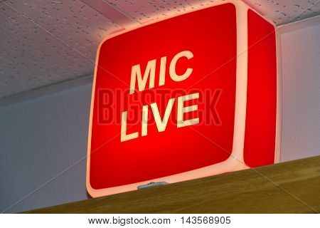Mic Live studio sign glowing with red light