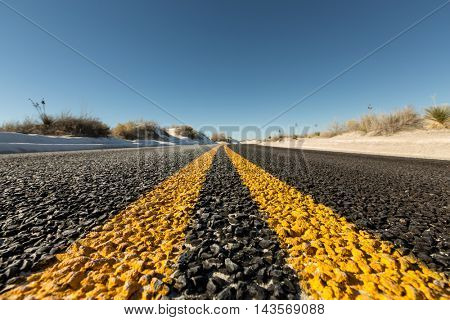 Yellow strips on road close-up, dividing line