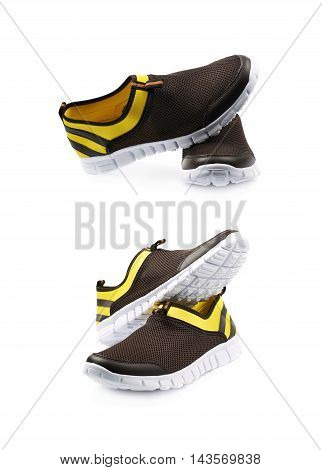 Pair of two light running sport shoes, colored yellow and black, composition isolated over the white background, set of two different foreshortenings