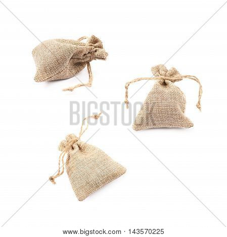 Tiny sackcloth bag with a tie string isolated over the white background, set of three different foreshortenings