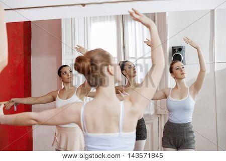 Reflection Of Ballerinas Performing