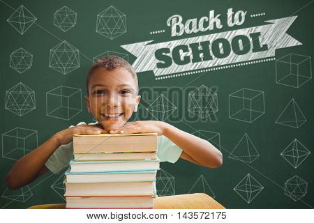 Portrait of boy leaning on stack of books against back to school message